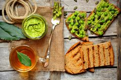 Raw, fresh alkaline food with avocado and peas pesto sandwich Stock Images