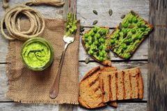 Raw, fresh alkaline food with avocado and peas pesto sandwich Stock Photos