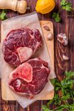 Raw fresh beef meat cross cut for ossobuco on cutting board. Stock Photo