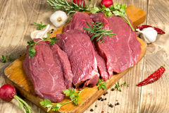 Raw, fresh beef meat with spices, seasoning ready for baking - roasting Royalty Free Stock Photography