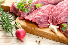 Raw, fresh beef meat with spices, seasoning ready for baking - roasting Stock Photography