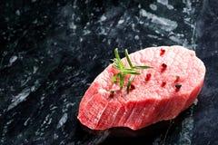 Raw fresh beef steak on dark marble background Stock Photo