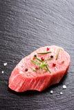 Raw fresh beef steak on dark stone background Stock Photography