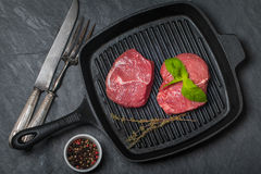 Raw fresh beef Steak on grill pan Stock Photography