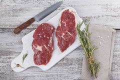 Raw fresh beef steak on a white cutting board Stock Photos