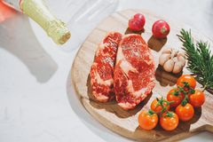 Raw fresh beef on white stone background, top view stock photo