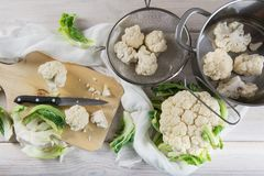 Raw cauliflower on the table of the kitchen Stock Photography