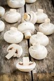 Raw fresh champignons on a wooden table stock photography