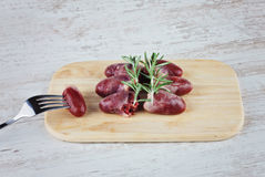 Raw fresh chicken hearts. On the wooden cutting board Royalty Free Stock Photo
