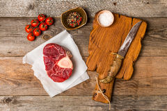 Raw fresh cross cut veal shank and meat cleaver Stock Images