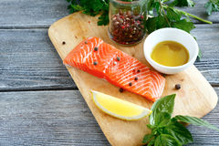 Raw fresh fish on a wooden board Royalty Free Stock Images