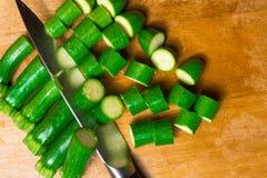 Raw fresh green mini zucchini on the wood background. Raw organic fresh mini green zucchini on the wood table Stock Photo