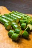 Raw fresh green mini zucchini on the wood background. Raw organic fresh mini green zucchini on the wood table Royalty Free Stock Photo