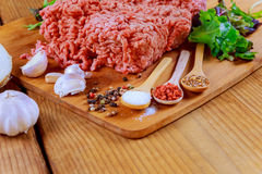 Raw fresh ground beef meat minced meat on plate. Raw fresh meat mince - minced meat on a wooden table Royalty Free Stock Photography