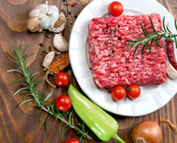 Raw fresh ground beef meat - minced meat on plate and spice Stock Images