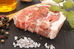 Raw fresh lamb chop with peppercorn, salt, oil and mint Stock Image