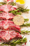 Raw fresh lamb loin chops with herbs and spices, preparation. Close up Royalty Free Stock Photos