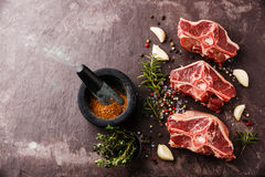 Raw fresh lamb loin chops with herbs Stock Image