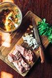 Raw fresh Lamb Meat ribs and seasonings on wooden background. Raw fresh Lamb Meat ribs and seasonings on the wooden background Royalty Free Stock Photo
