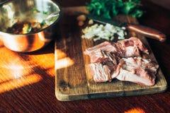 Raw fresh Lamb Meat ribs and seasonings on wooden background. Raw fresh Lamb Meat ribs and seasonings on the wooden background Stock Photo