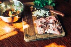 Raw fresh Lamb Meat ribs and seasonings on wooden background. Raw fresh Lamb Meat ribs and seasonings on the wooden background Stock Images
