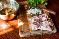 Raw fresh Lamb Meat ribs and seasonings on wooden background. Raw fresh Lamb Meat ribs and seasonings on the wooden background Royalty Free Stock Images
