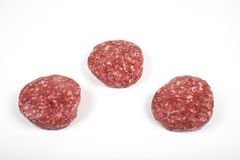 Raw fresh large beef burger or cutlets isolated on white background.  Royalty Free Stock Photography