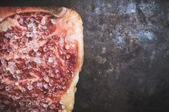 Raw fresh marble T-bone meat on the rustic background. Selective focus. Shallow depth of field stock photography