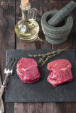 Raw fresh marbled beef Steak. Olive oil and seasonings on wooden table Stock Images