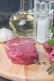 Raw fresh marbled beef Steak. Olive oil and seasonings on wooden table Stock Image