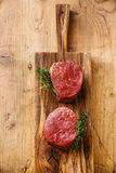 Raw fresh marbled meat Steak filet mignon. On wooden background Stock Photos