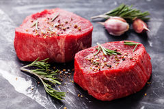 Raw fresh marbled meat Steak. And seasonings on dark marble background close-up stock images