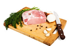 Raw fresh meat on board with condiments. On white background Royalty Free Stock Photography
