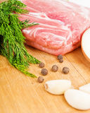 Raw fresh meat on board with condiments. On white background Royalty Free Stock Photos