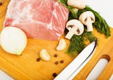Raw fresh meat on board with condiments. On white background Royalty Free Stock Image
