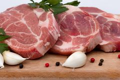 Raw fresh meat on board with condiments Royalty Free Stock Photography