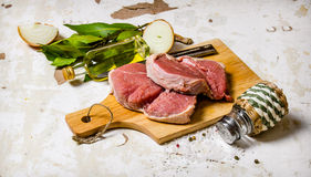 Raw fresh meat on board with spices. Stock Photography