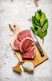 Raw fresh meat on board with spices. Royalty Free Stock Image