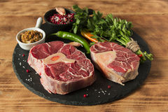 Raw fresh meat on the bone cut  Osso Buco on board Royalty Free Stock Images