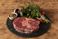 Raw fresh meat on the bone cut  Osso Buco on board Royalty Free Stock Photos