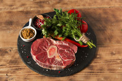 Raw fresh meat on the bone cut  Osso Buco on board Royalty Free Stock Image