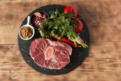Raw fresh meat on the bone cut  Osso Buco on board Royalty Free Stock Photo