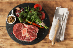 Raw fresh meat on the bone cut  Osso Buco on board Stock Photography