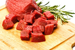 Raw fresh meat cubes with greens Stock Images