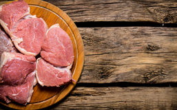 Raw fresh meat on cutting board. On wooden table. Royalty Free Stock Photos