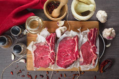 Raw fresh meat rib eye steak composition on wooden background Stock Image