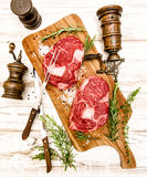 Raw fresh meat Rib Eye Steak with herbs. Food background Stock Photos