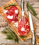Raw fresh meat Ribeye Steak herbs spices on wooden table Royalty Free Stock Photography