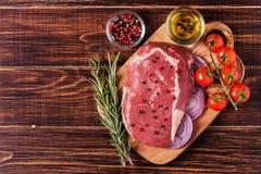 Raw fresh meat Ribeye Steak, seasoning. Stock Photo