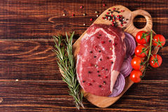 Raw fresh meat Ribeye Steak, seasoning. Royalty Free Stock Photo